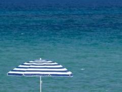 Umbrella on asandy beach.